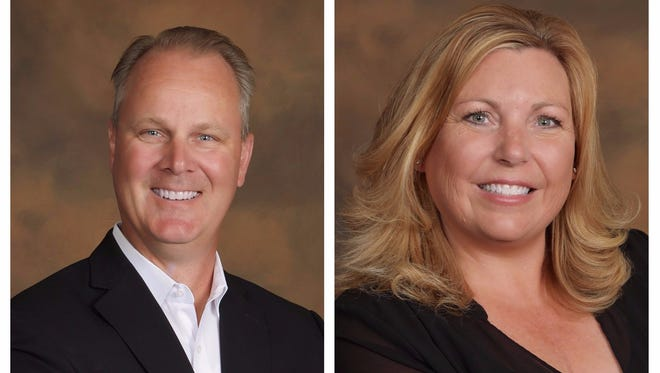 Eric Anderson and Kimberly Lang staff the Land Home Financial Services branch in Sioux Falls.