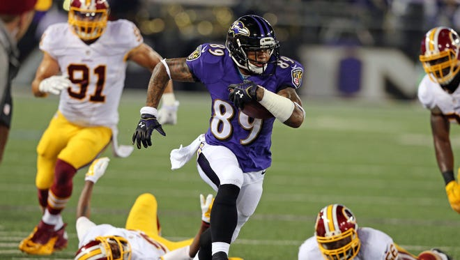 Baltimore Ravens wide receiver Steve Smith (89) gains yardage after his catch against the Washington Redskins at M&T Bank Stadium.