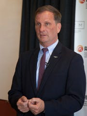 Congressman Chris Stewart visits with other politicians
