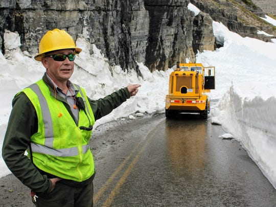 Brian Paul, roads crew leader for Glacier National Park, points to the notorious Big Drift near Logan Pass on Going-to-the-Sun Road. Crews finally pushed through the drift on Thursday, connecting the east and west sides of the park.