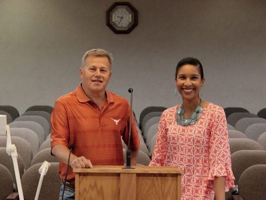 Commission Clerk Todd Hopkins and Caddo Parish spokeswoman Krystle Grindley near the public comments microphone.