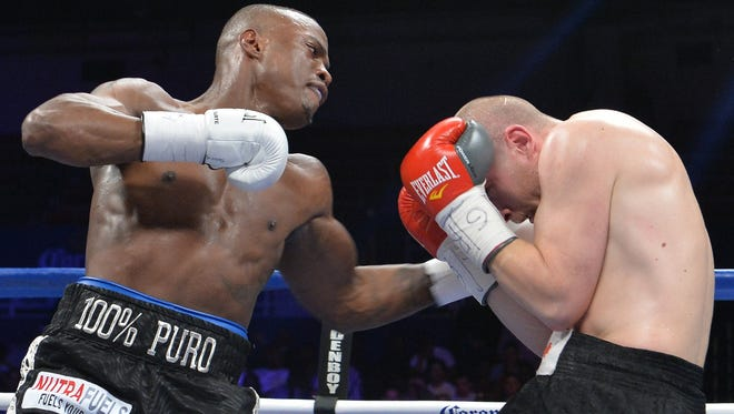 Peter Quillin, left, unloads a left against Lukas Konecny of the  Czech Republic during their WBO middleweight title fight  at the DC Armory. Quillin won by unanimous decision.
