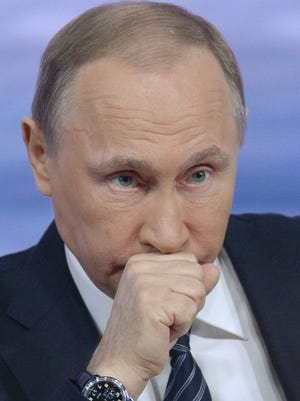 Russian President Vladimir Putin looks on during his annual press conference in Moscow on Dec. 17.