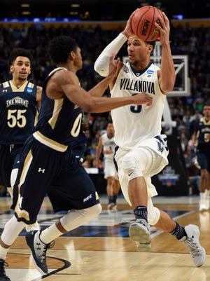 Villanova guard Josh Hart (3) drives to the basket against Mount St. Mary's guard Junior Robinson (0) in the second half.