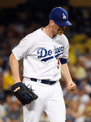 Los Angeles Dodgers pitcher Alex Wood (57) reacts against the Arizona Diamondbacks during the sixth inning at Dodger Stadium.