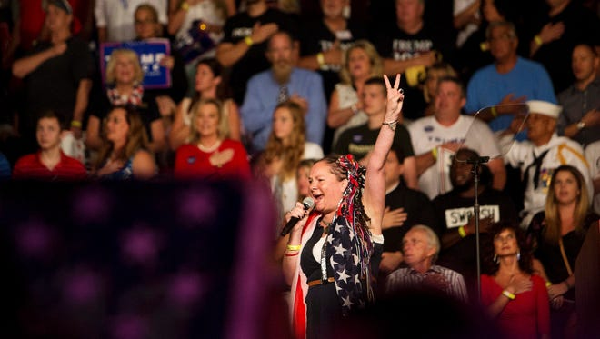 The National Anthem is sung by Jennifer Beaudoin, 37 before the Donald Trump Rally at Germain Arena on Monday.