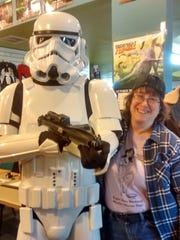 """Stacy Korn (left), owner of Comic Fusion, posed with an Imperial Stormtrooper from """"Star Wars"""" at the 2015 Superhero Weekend sponsored by her store.  The 2016 Superhero Weekend takes place August 20 and 21.  Funds raised from the event go to help advocates for children in the legal system."""