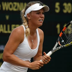 Denmark's Caroline Wozniacki waits to receive a serve from Czech Republic's Denisa Allertova during their women's singles second round match on day four of the 2015 Wimbledon Championships at The All England Tennis Club in Wimbledon, on July 2, 2015.