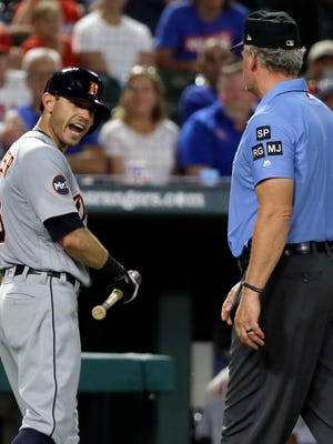 Detroit Tigers second baseman Ian Kinsler, left, argues with crew chief Ted Barrett, right, after Kinsler was ejected by home plate umpire Angel Hernandez in the fifth inning against the Texas Rangers on Aug. 14, 2017.