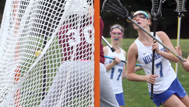 Millbrook's Kaitlyn Daly scores on James O'Neill goalie Caroline Roscoe during the Section 9 Class D girls lacrosse championship at the Newburgh Free Academy May 23, 2017. Millbrook defeated James O'Neill 16-4.