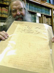 State Archivist Gregory Sanford holds the original