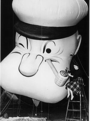 The Popeye balloon gets a touch-up before its big day. The Goodyear-made balloon was in the 1957 Macy's Thanksgiving Day Parade.