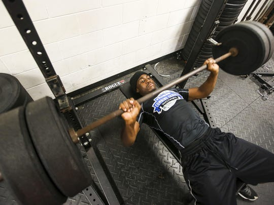 Zaquandre White works out in the weight room of the North Fort Myers high school. Friday 24, 2015.