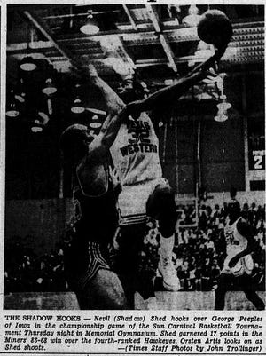 THE SHADOW HOOKS - Nevil (Shadow) Shed hooks over George Peeoples of Iowa in the championship game of the Sun Carnival Basketball Tournament Thursday night in Memorial Gymasium. shed garnered 17 pionts in the Miners' 86-68 win over the fourth-ranked Hawkeyes. Orsten Artis looks on as Shed shoots.