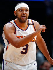 Phoenix Suns forward Jared Dudley reacts after hitting a 3-point basket against the Denver Nuggets during the first half of an NBA basketball game Friday, Jan. 19, 2018, in Denver. (AP Photo/David Zalubowski)