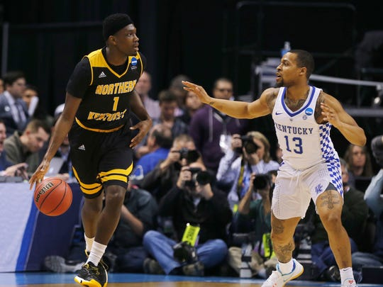 Northern Kentucky Norse forward Jordan Garnett (1) tries to make a pass around Kentucky Wildcats guard Isaiah Briscoe (13) during the first half of the NCAA Men's Basketball Championship in Indianapolis on Friday March 17, 2017.