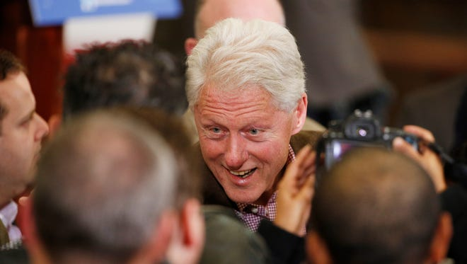 Former president Bill Clinton greets people after a rally at the United Brotherhood of Carpenters International Training Center in Las Vegas on Feb. 5, 2016.