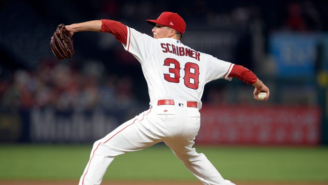 August 29, 2017; Anaheim, CA, USA;  Los Angeles Angels relief pitcher Troy Scribner (38) throws in the third inning against the Oakland Athletics at Angel Stadium of Anaheim.