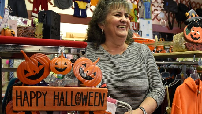 Marilyn Smith and her South Lyon ReSale shop will be welcoming trick-or-treaters on Halloween and like many other downtown merchants has spruced up her shop and display windows with some decorations.
