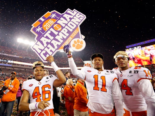 The Clemson Tigers celebrate after defeating the Alabama