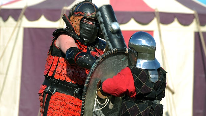 Richard Beckish, a 13th century Mongol Warrior, battles for the crowd Saturday during a renaissance faire
