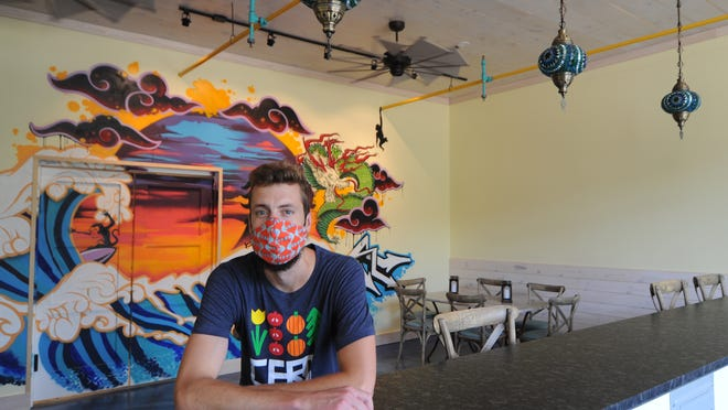 Co-owner Mike Strangfeld sits inside the new 3 Monkeys Street Bar + Kitchen + Sushi. The new restaurant is a sister location of the Mad Minnow Bar and Kitchen on Main Street in Harwich Port.