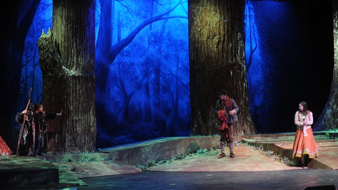 """From left, Maya Mockert, Jack Caulfield and Madi Sass rehearse their scene in """"Into the Woods."""" The massive sets required help from students and parent volunteers at Fond du Lac High School."""