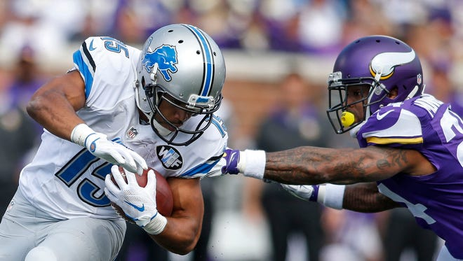 Sep 20, 2015; Detroit Lions wide receiver Golden Tate (15) gets around Minnesota Vikings cornerback Captain Munnerlyn (24) on a pass in the third quarter at TCF Bank Stadium.
