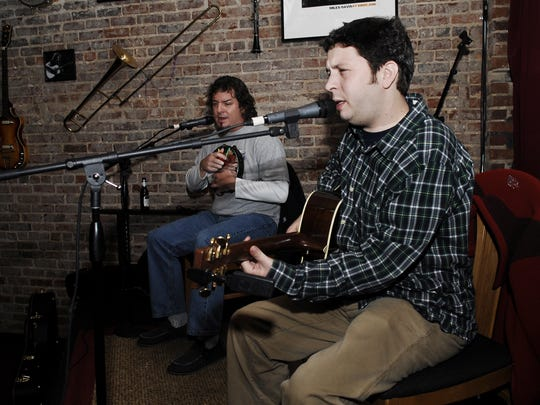 Charles Hedgepath plays onstage with a friend from Charleston at Smiley's Acoustic Cafe on Wednesday, Dec. 18, 2008.