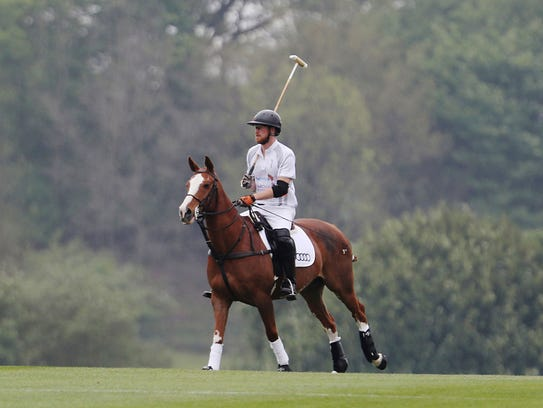 Prince Harry takes part in an annual charity polo match
