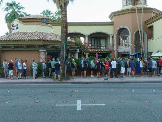 A line forms outside of Oscar's Cafe and Bar on Sunday for its weekly tea dance party, Sunday, October 16, 2017.