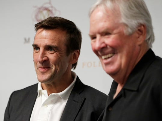"""FILE - In this Wednesday, July 13, 2016, file photo, George McPhee, left, and NHL's expansion Las Vegas franchise owner Bill Foley attend a news conference in Las Vegas. The expansion Vegas Golden Knights can begin making trades and signing free agents for next season as soon as Foley's final payment clears. The expansion draft is almost four months away, but Vegas could get some clarity and some assets very soon. """"We've been talking with teams here for a few weeks now,"""" general manager McPhee said. """"Teams are looking for some certainty with their rosters and obviously trying to improve their rosters before the trading deadline and they want to talk to us to see if there's a player that we could agree upon that for a couple months from now to claim, which would make their life easier."""" (AP Photo/John Locher, File)"""