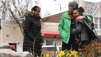 Unveiling of the Child Safety Forever Fountain in Hillsdale on Thursday April 19, 2018, which marks 45 years since Joan D'Alessandro's death. (From left) Daljit Kaur looks on as Rosemarie D'Alessandro hugs Aurora Abdool in front of the newly unveiled fountain.