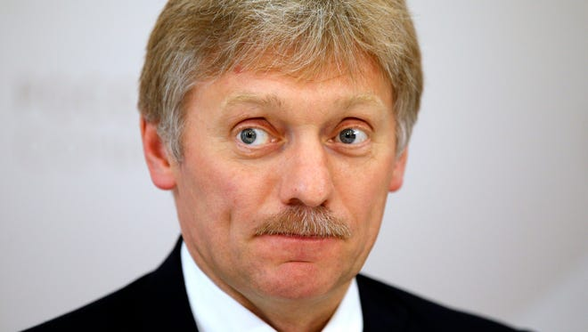 In this file photo taken on Thursday, May 19, 2016, Russian President Vladimir Putin's press secretary Dmitry Peskov listens for a question during his news conference at the ASEAN Russia summit, in the Black Sea resort of Sochi, Russia.