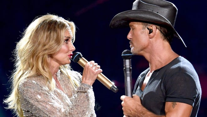 Faith Hill and Tim McGraw perform during their Soul2Soul world tour in Los Angeles.