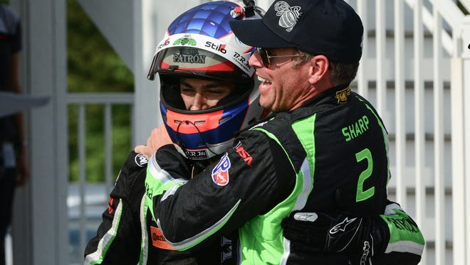 Pipo Derani gets a hug from team co-owner Scott Sharp in victory lane.