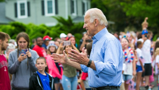 Vice President Joe Biden surprises the crowd as he makes an appearance in the Hockessin Fourth of July Parade on Monday. Cloudy skies dominated most of the afternoon on Independence Day, and numerous events were postponed.
