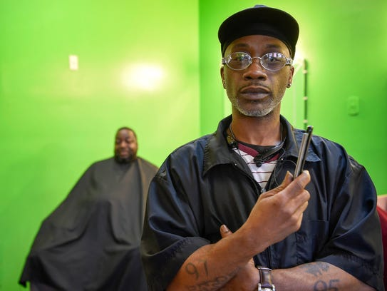 Corey Collins, 44, a barber the Elite Salon in Antioch