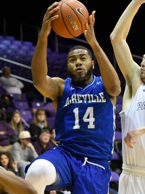 UNC Asheville's Ahmad Thomas (14) limped to the finish a week ago, but he says all is well as the Bulldogs enter the Big South Conference Tournament
