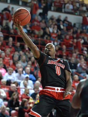 Louisville's Terry Rozier goes up for a layup during the first half of an NCAA college basketball game against Western Kentucky Saturday, Dec. 20, 2014, in Bowling Green, Ky.