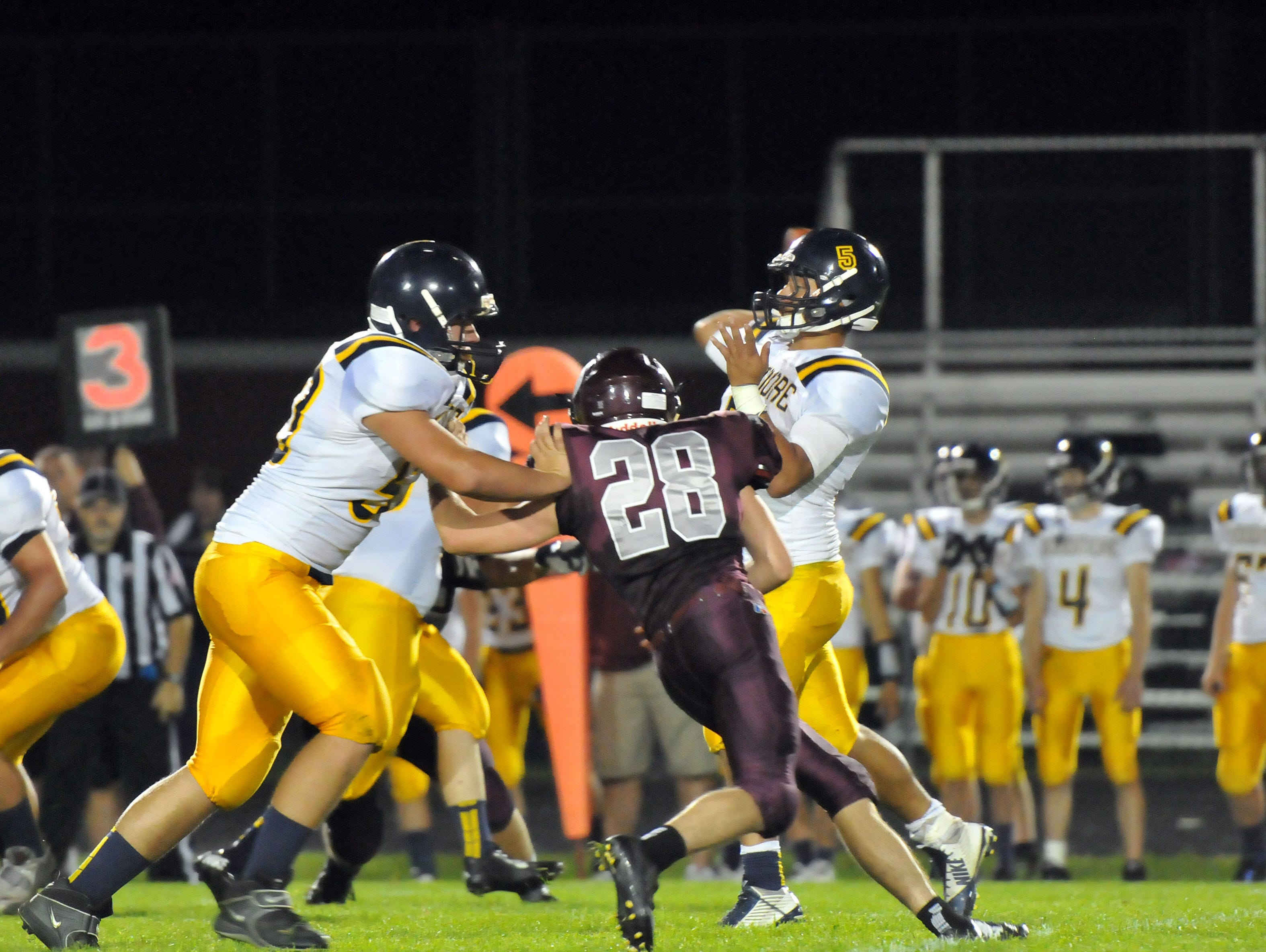Woodmore's Connor Bringman throws the ball during the Wildcats game at Genoa on Friday night.