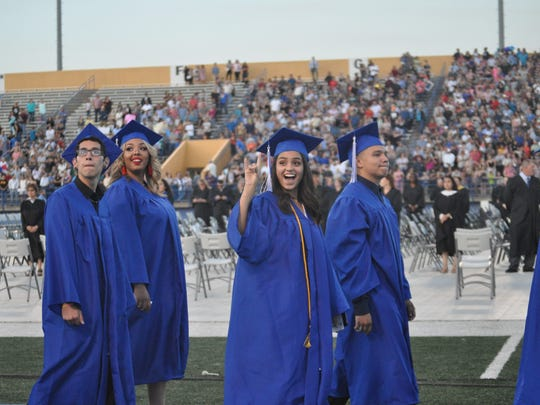 Carlsbad High School seniors greet family and friends at commencement Friday, May 18, 2018.