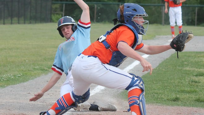 Livonia Franklin's Kyle Wollman beats the tag of Garden City catcher Austin Even with the eventual winning run in the bottom of the sixth inning of Tuesday's pre-district.
