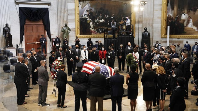 Members of the Congressional Black Caucus, say farewell at the conclusion of a service Monday for the late Rep. John Lewis, D-Ga., a key figure in the civil rights movement and a 17-term congressman from Georgia, as he lies in state at the Capitol in Washington.