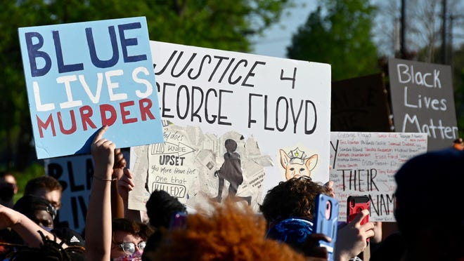 A group that helped organize Saturday's Stand with Minneapolis protest is planning a second demonstration on Tuesday. Protesters, seen here on Saturday, May 30, 2020, at the Rockford Police District 1 station on West State Street, rallied in Haskell Park and marched through downtown Rockford earlier in the day.