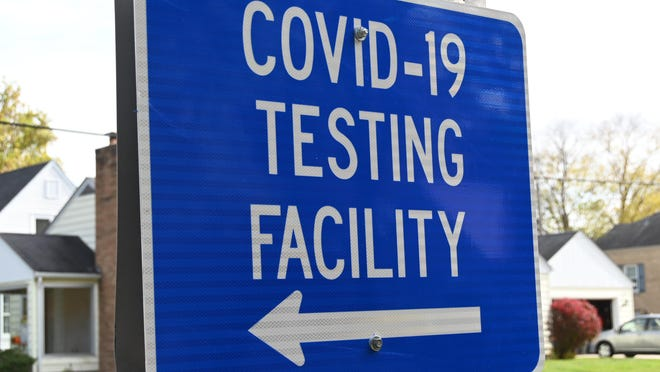 A sign at Guilford Road and Parkview Avenue in Rockford points toward a COVID-19 testing facility at the University of Illinois College of Medicine at Rockford.