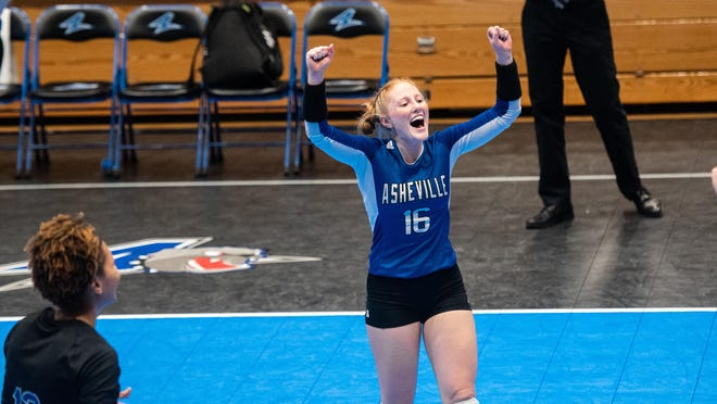 UNC Asheville senior libero Kasey West, a former West Henderson High standout, celebrates a point during a previous match at UNC Asheville.