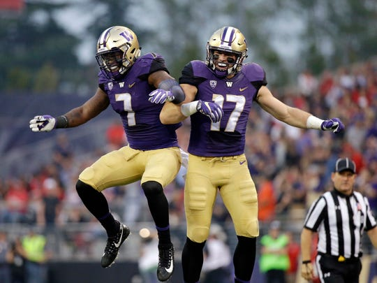 Washington's Tevis Bartlett (17) celebrates with Keishawn Bierria after intercepting a pass against Fresno State in September.