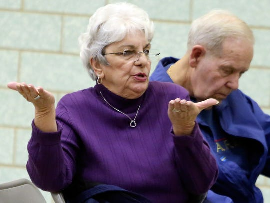 Marie Lulfs asks a question during a meeting on the