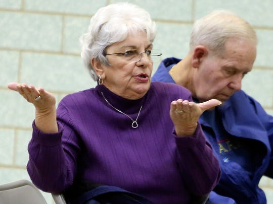Marie Lulfs asks a question during a meeting on the Christina Operating Referendum at Shue-Medill Middle School on Wednesday. The proposal has divided residents on the question of school funding.